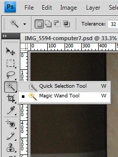 Right click on the Quick Selection Tool at the leftside of the interface. Select the Magic Wand Tool.