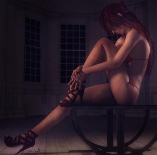 Victoria7 in heels, in a pin-up pose, on a chair at night. She is looking down and seems alone and lonely.